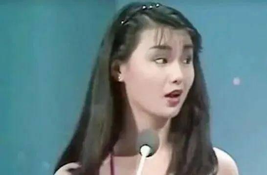 摩登6登录19岁的张曼玉长发飘飘,穿着连身泳装出镜,清纯甜美充满了青春活力(图3)