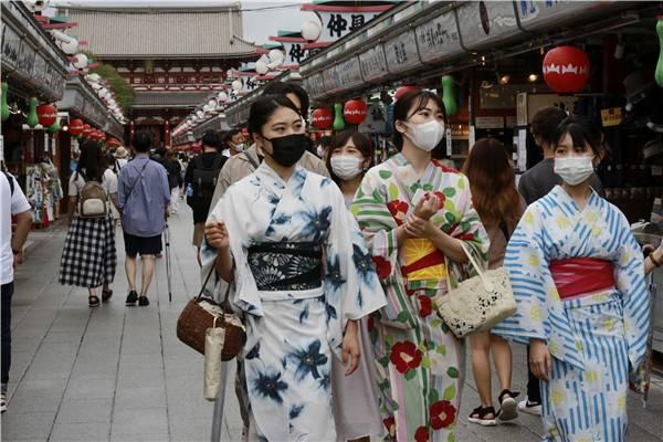 日本新冠疫情持续告急!病例日增首次超过两万